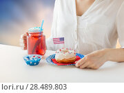 woman celebrating american independence day. Стоковое фото, фотограф Syda Productions / Фотобанк Лори