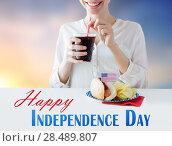 Купить «happy woman celebrating american independence day», фото № 28489807, снято 28 мая 2015 г. (c) Syda Productions / Фотобанк Лори