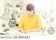 Купить «happy asian young woman student learning at home», фото № 28489831, снято 9 марта 2016 г. (c) Syda Productions / Фотобанк Лори