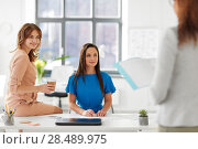Купить «businesswomen at presentation in office», фото № 28489975, снято 17 марта 2018 г. (c) Syda Productions / Фотобанк Лори