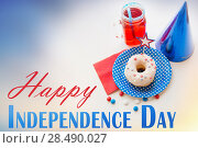 Купить «donut with juice and candies on independence day», фото № 28490027, снято 28 мая 2015 г. (c) Syda Productions / Фотобанк Лори