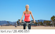 Купить «happy young woman riding bicycle outdoors», фото № 28490051, снято 5 июля 2015 г. (c) Syda Productions / Фотобанк Лори