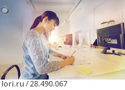 architect woman drawing on blueprint at office. Стоковое фото, фотограф Syda Productions / Фотобанк Лори