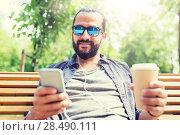 Купить «man with earphones and smartphone drinking coffee», фото № 28490111, снято 2 июня 2016 г. (c) Syda Productions / Фотобанк Лори