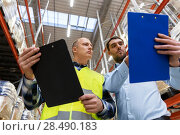 Купить «worker and businessman with clipboard at warehouse», фото № 28490183, снято 9 декабря 2015 г. (c) Syda Productions / Фотобанк Лори