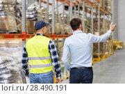 Купить «businessman showing warehouse to worker», фото № 28490191, снято 9 декабря 2015 г. (c) Syda Productions / Фотобанк Лори