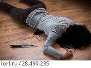 Купить «dead woman body lying on floor at crime scene», фото № 28490235, снято 5 мая 2017 г. (c) Syda Productions / Фотобанк Лори