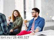 Купить «creative team drinking coffee at office», фото № 28490327, снято 1 апреля 2018 г. (c) Syda Productions / Фотобанк Лори