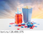 Купить «drink and popcorn with candies on independence day», фото № 28490375, снято 28 мая 2015 г. (c) Syda Productions / Фотобанк Лори