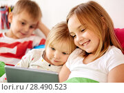 Купить «happy little kids with tablet pc in bed at home», фото № 28490523, снято 15 октября 2017 г. (c) Syda Productions / Фотобанк Лори