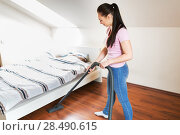 Купить «woman or housewife with vacuum cleaner at home», фото № 28490615, снято 29 апреля 2018 г. (c) Syda Productions / Фотобанк Лори