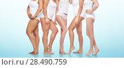 Купить «group of happy diverse women in white underwear», фото № 28490759, снято 17 апреля 2016 г. (c) Syda Productions / Фотобанк Лори