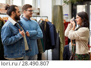 Купить «friends photographing at vintage clothing store», фото № 28490807, снято 30 ноября 2017 г. (c) Syda Productions / Фотобанк Лори