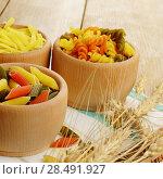 Купить «Raw tricolor pasta set on the wooden table», фото № 28491927, снято 13 января 2013 г. (c) Ingram Publishing / Фотобанк Лори