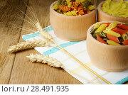 Купить «Raw tricolor pasta set on the wooden table», фото № 28491935, снято 13 января 2013 г. (c) Ingram Publishing / Фотобанк Лори