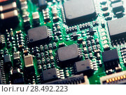 Купить «Modern computer chip macro photo», фото № 28492223, снято 16 января 2019 г. (c) Ingram Publishing / Фотобанк Лори