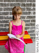 Купить «Girl draws on the album sitting bench 5057», фото № 28492315, снято 22 октября 2018 г. (c) Ingram Publishing / Фотобанк Лори