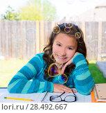 Купить «American latin teen girl with soap bubbles doing homework on backyard», фото № 28492667, снято 16 июля 2019 г. (c) Ingram Publishing / Фотобанк Лори