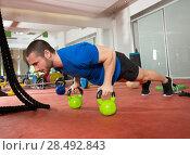 Купить «Crossfit fitness man push ups Kettlebells pushup exercise at gym workout», фото № 28492843, снято 19 апреля 2019 г. (c) Ingram Publishing / Фотобанк Лори