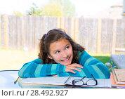 Купить «American latin teen girl with soap bubbles doing homework on backyard», фото № 28492927, снято 16 июля 2019 г. (c) Ingram Publishing / Фотобанк Лори