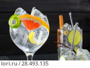 Купить «Gin tonic varied cocktails with lima lemon and grapefruit vanilla and cinnamon spices», фото № 28493135, снято 21 апреля 2019 г. (c) Ingram Publishing / Фотобанк Лори