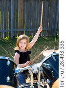 Купить «Drummer blond kid girl playing drums in tha backyard lawn», фото № 28493335, снято 19 июля 2018 г. (c) Ingram Publishing / Фотобанк Лори