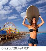 Купить «Brunette surfer teen girl holding surfboard in Santa Monica beach California», фото № 28494031, снято 20 июня 2019 г. (c) Ingram Publishing / Фотобанк Лори