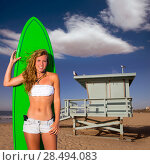 Купить «Blond surfer teen girl holding surfboard in Santa Monica Lifeguard house California», фото № 28494083, снято 20 июня 2019 г. (c) Ingram Publishing / Фотобанк Лори