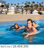 Купить «Teenager surfer group boys and girls swimming over the surfboard in santa monica california», фото № 28494395, снято 20 июня 2019 г. (c) Ingram Publishing / Фотобанк Лори