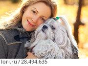 Купить «Young woman with favorite dog», фото № 28494635, снято 6 октября 2013 г. (c) Ingram Publishing / Фотобанк Лори