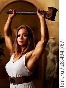 Купить «Young woman bodybuilder with hammer», фото № 28494767, снято 6 октября 2013 г. (c) Ingram Publishing / Фотобанк Лори