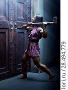 Купить «Woman warrior with axe standing at the door», фото № 28494779, снято 6 октября 2013 г. (c) Ingram Publishing / Фотобанк Лори