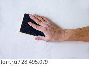 Купить «Plastering man hand sanding the plaster in white wall», фото № 28495079, снято 12 февраля 2013 г. (c) Ingram Publishing / Фотобанк Лори