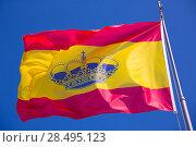 Купить «Spain red and yellow flaw waving on wind under blue sky», фото № 28495123, снято 12 мая 2013 г. (c) Ingram Publishing / Фотобанк Лори