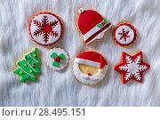 Купить «Christmas cookies Xmas tree Santa snowflake on white fur background», фото № 28495151, снято 8 декабря 2013 г. (c) Ingram Publishing / Фотобанк Лори