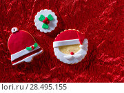 Купить «Christmas cookies Santa face and Xmas bell on red background with copy space», фото № 28495155, снято 8 декабря 2013 г. (c) Ingram Publishing / Фотобанк Лори