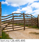 Menorca traditional wooden fence gate in Balearic islands. Стоковое фото, фотограф Tono Balaguer / Ingram Publishing / Фотобанк Лори