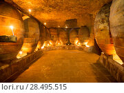 Купить «Antique winery in Spain with clay vessels terracotta amphora  pots Mediterranean tradition with candlelight», фото № 28495515, снято 10 октября 2013 г. (c) Ingram Publishing / Фотобанк Лори