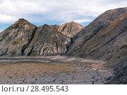Купить «Landscape - the hollow with a dry clay bottom among the deserted lifeless hills», фото № 28495543, снято 20 мая 2018 г. (c) Евгений Харитонов / Фотобанк Лори
