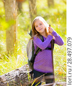 Купить «Hiking kid girl with backpack in autum poplar trees forest and walking stick», фото № 28497079, снято 6 октября 2013 г. (c) Ingram Publishing / Фотобанк Лори