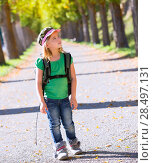 Купить «Blond explorer kid girl walking with backpack in autumn trees track», фото № 28497131, снято 5 октября 2013 г. (c) Ingram Publishing / Фотобанк Лори