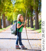 Купить «Blond explorer kid girl walking with backpack hiking in autumn trees track holding stick», фото № 28497155, снято 5 октября 2013 г. (c) Ingram Publishing / Фотобанк Лори