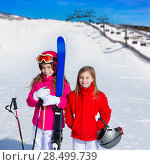 Купить «Kid girls sister in winter snow with ski equipment helmet goggles poles», фото № 28499739, снято 26 января 2014 г. (c) Ingram Publishing / Фотобанк Лори
