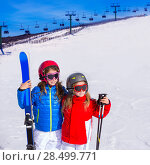 Купить «Kid girls sister in winter snow with ski equipment helmet goggles poles», фото № 28499771, снято 26 января 2014 г. (c) Ingram Publishing / Фотобанк Лори