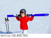 Купить «Kid girl winter snow holding ski equipment helmet goggles poles», фото № 28499783, снято 26 января 2014 г. (c) Ingram Publishing / Фотобанк Лори