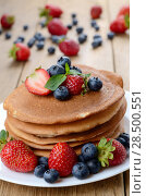 Купить «Stack of pancakes with strawberries raspberries and blueberries on white plate», фото № 28500551, снято 16 августа 2013 г. (c) Ingram Publishing / Фотобанк Лори