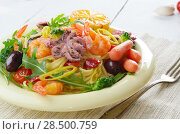 Купить «Seafood spaghetti pasta dish with octopus, shrimps, cherry tomatoes and olives», фото № 28500759, снято 21 октября 2019 г. (c) Ingram Publishing / Фотобанк Лори