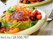 Купить «Seafood spaghetti pasta dish with octopus, shrimps, cherry tomatoes and olives», фото № 28500787, снято 26 апреля 2019 г. (c) Ingram Publishing / Фотобанк Лори