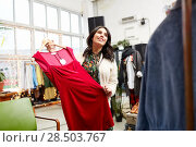 Купить «happy woman choosing dress at clothing store», фото № 28503767, снято 30 ноября 2017 г. (c) Syda Productions / Фотобанк Лори