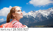 Купить «smiling woman with backpack over alps mountains», фото № 28503927, снято 25 июля 2015 г. (c) Syda Productions / Фотобанк Лори
